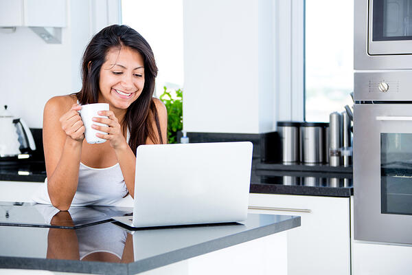 Woman checking her emails in the morning on a laptop-1