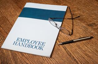 How do I write an employee handbook?