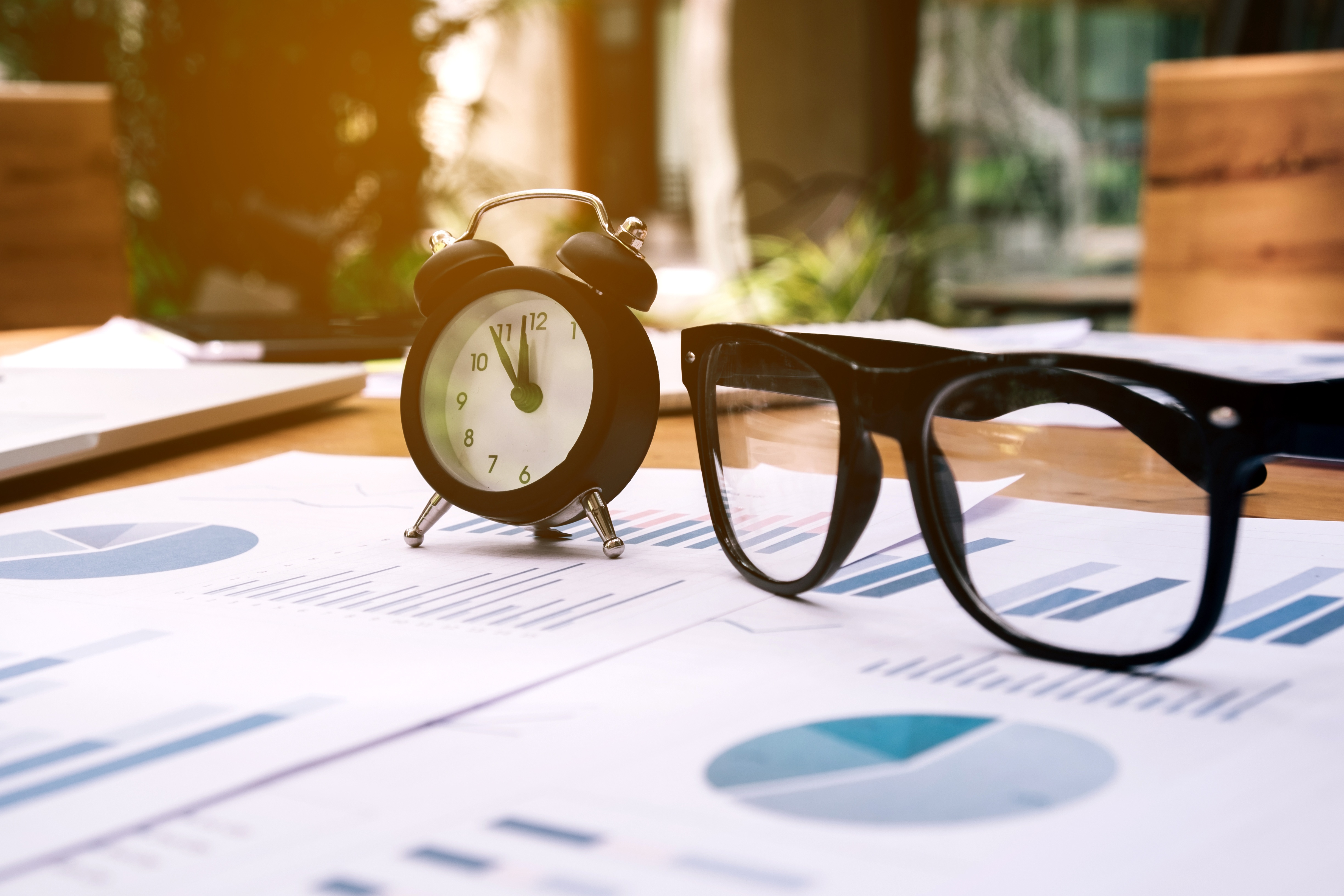 Glasses-and-clock-on-the-business-paper.-Report-chart-870388238_4896x3264